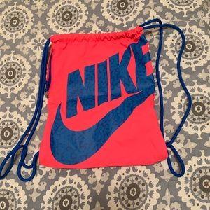 NIKE draw string bag.